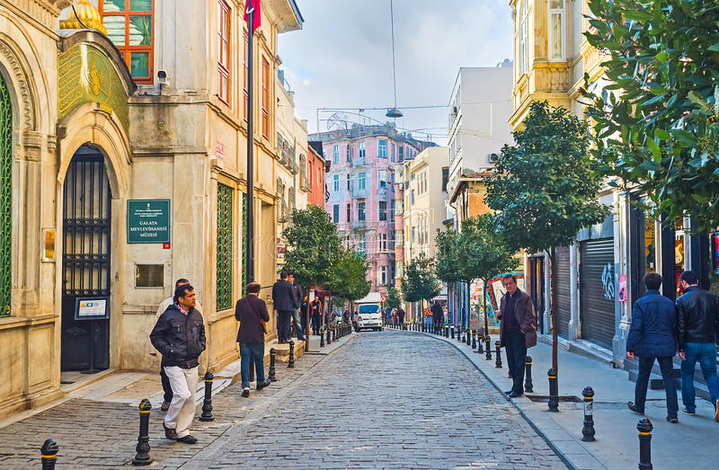 The descent to the Golden Horn Bay. ISTANBUL, TURKEY - JANUARY 22, 2015: The Independence Avenue with the entrance to Galata Mevlevi Lodge from the left, on stock photo