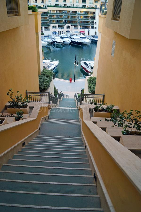 Sightseeing Malta. Descent with unusually long stairs to the marina in the St. Julian`s royalty free stock photos