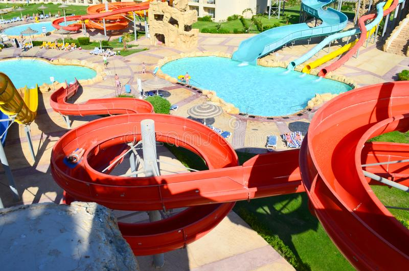 Descent on the water slide in aqua park. View from above royalty free stock image