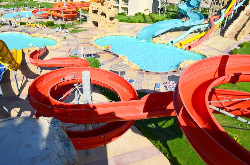 Descent on the water slide in aqua park. View from above stock image