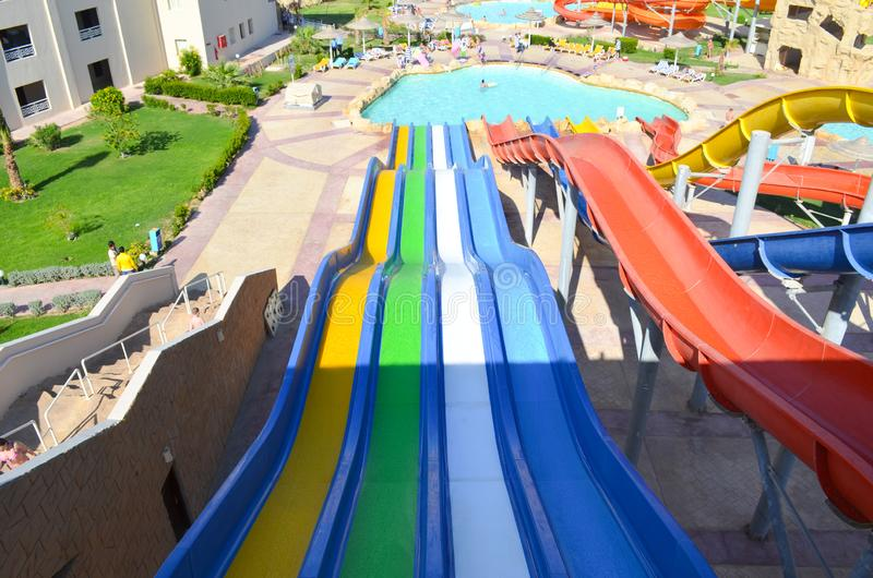 Descent on the water slide in aqua park. View from above stock images