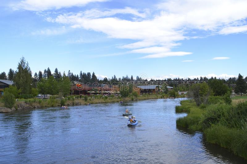 Deschutes River in Bend, Oregon. People rafting in Deschutes River in Bend, Oregon royalty free stock image