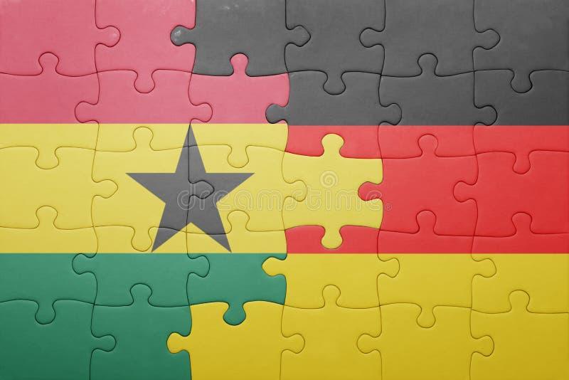 desconcierte con la bandera nacional de Alemania y de Ghana libre illustration