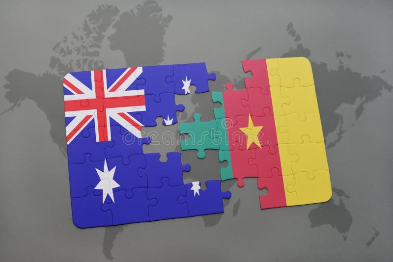 desconcierte con la bandera nacional de Australia y del Camerún en un fondo del mapa del mundo foto de archivo libre de regalías