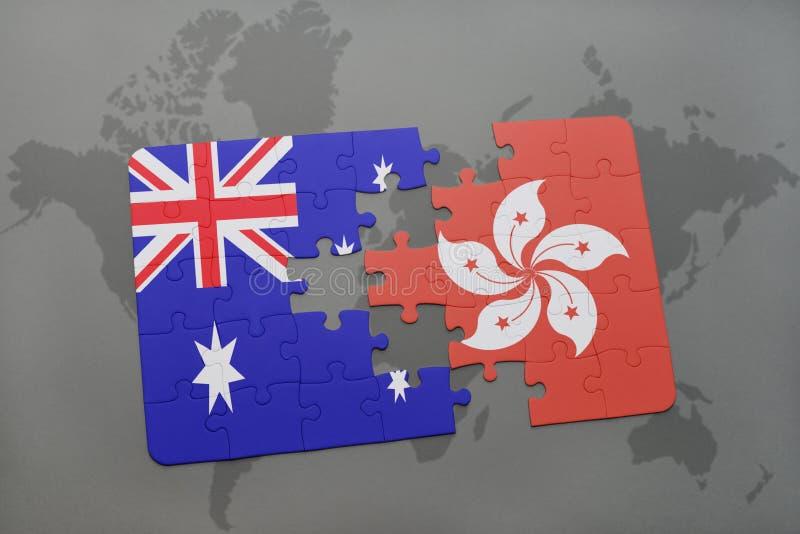 desconcierte con la bandera nacional de Australia y de Hong-Kong en un fondo del mapa del mundo imagen de archivo