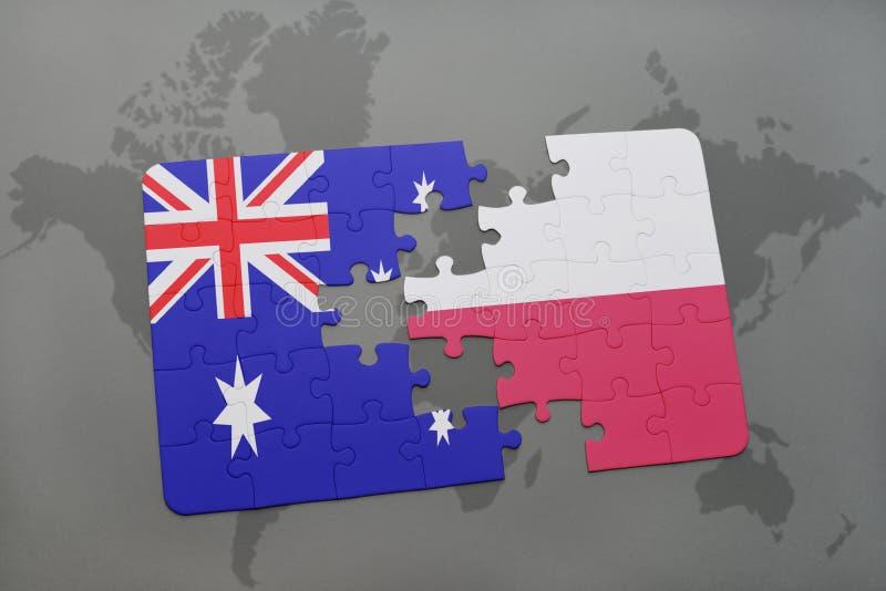Desconcierte con la bandera nacional de Australia y de Polonia en un fondo del mapa del mundo foto de archivo