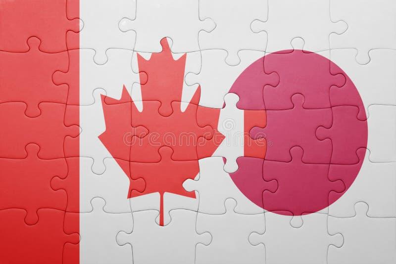 Desconcierte con la bandera nacional de Canadá y de Japón foto de archivo