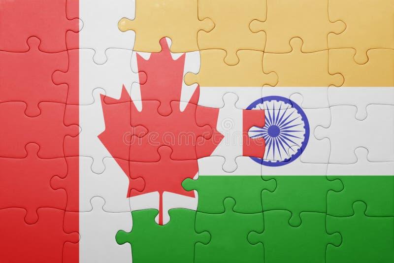 Desconcierte con la bandera nacional de Canadá y de la India fotografía de archivo libre de regalías