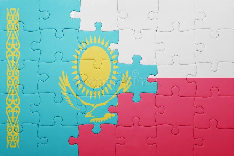 Desconcierte con la bandera nacional de Kazajistán y de Polonia imagen de archivo libre de regalías