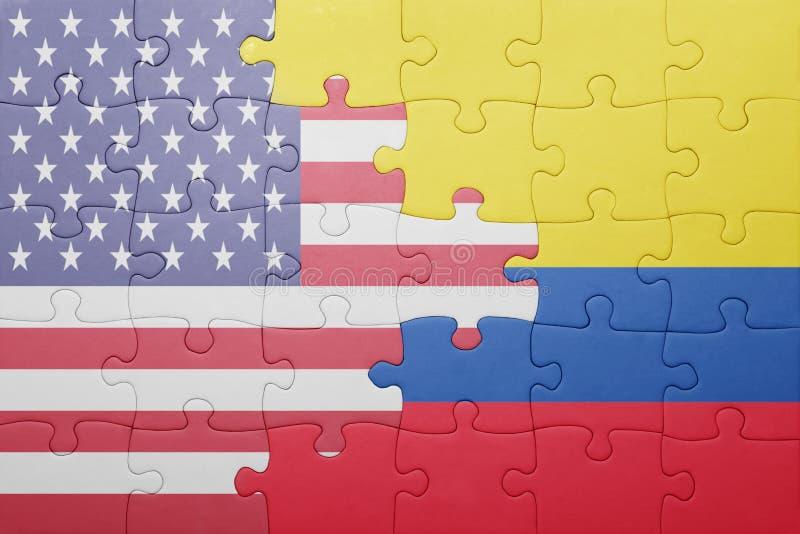 Desconcierte con la bandera nacional de los Estados Unidos de América y de Colombia fotos de archivo libres de regalías