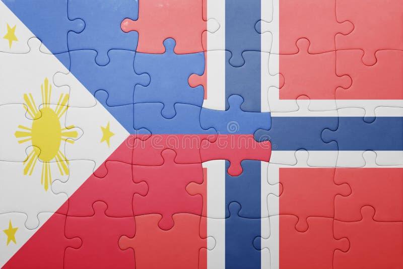 Desconcierte con la bandera nacional de Noruega y de Filipinas imagen de archivo libre de regalías