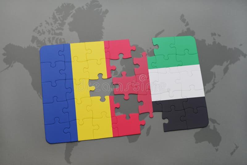 desconcierte con la bandera nacional de Rumania y de United Arab Emirates en un mapa del mundo foto de archivo libre de regalías