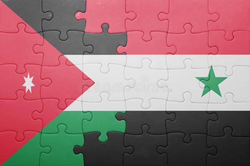Desconcierte con la bandera nacional de Siria y de Jordania fotografía de archivo libre de regalías