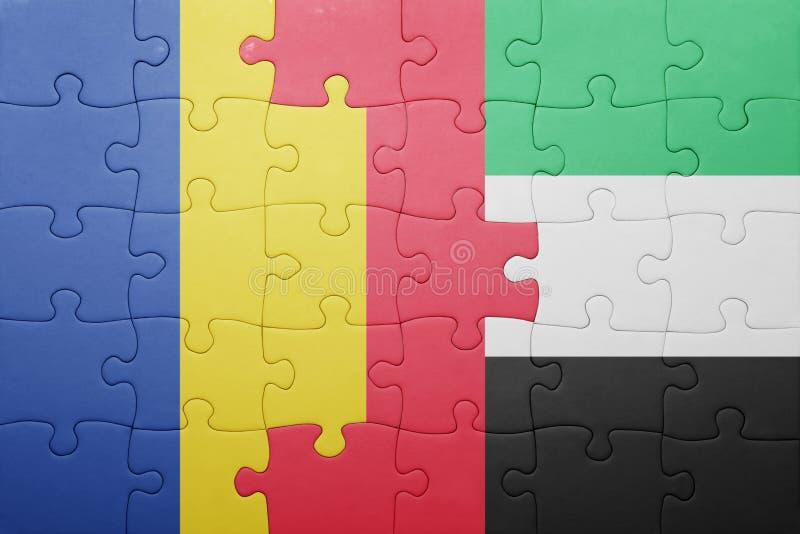Desconcierte con la bandera nacional de United Arab Emirates y de Rumania foto de archivo libre de regalías