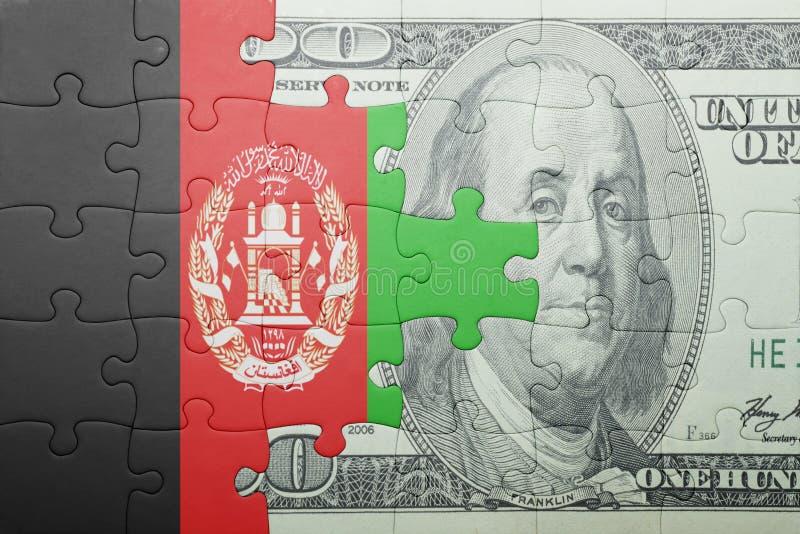 Desconcierte con la bandera nacional del billete de banco de Afganistán y del dólar foto de archivo libre de regalías