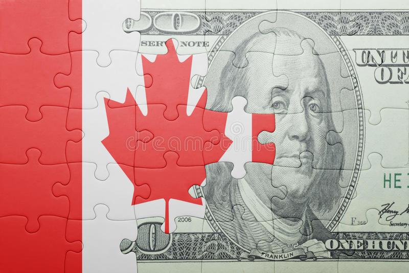 Desconcierte con la bandera nacional del billete de banco de Canadá y del dólar fotografía de archivo