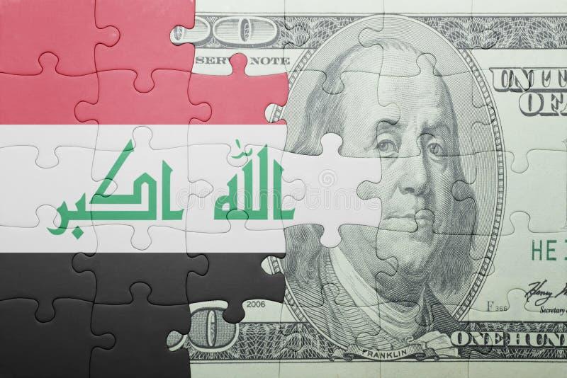 Desconcierte con la bandera nacional del billete de banco de Iraq y del dólar foto de archivo libre de regalías
