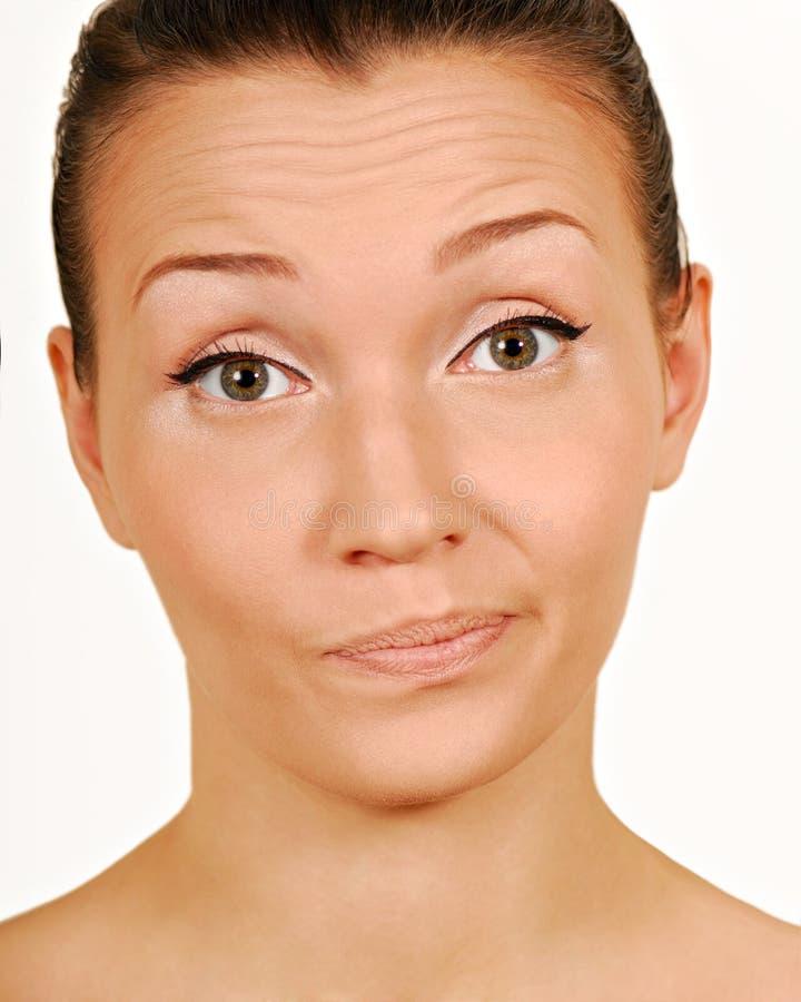 Desconfianza. Fabricación de una cara. imagen de archivo libre de regalías