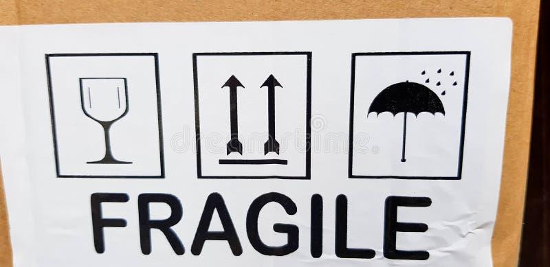 Descrição frágil na caixa de cartão imagens de stock royalty free
