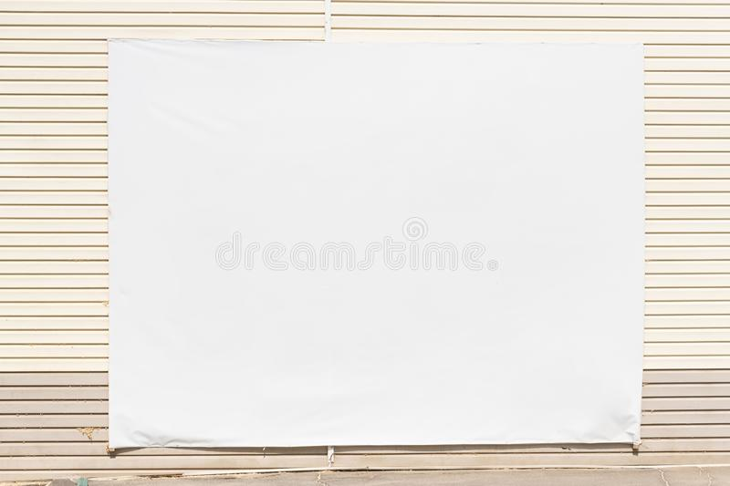 Blank billboard on the wall and wooden bench in empty hall, mock up stock images