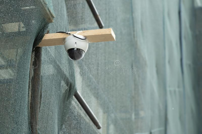 CCTV Camera Operating in construction site. Description: CCTV Camera Operating in construction site, technology, monitoring, surveillance, control, dome, guard stock photography