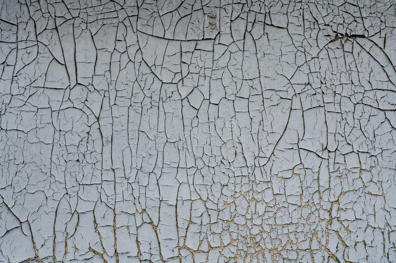 Rusty metal background with flaking,cracking blue gray paint cover.Industrial close up background stock photo