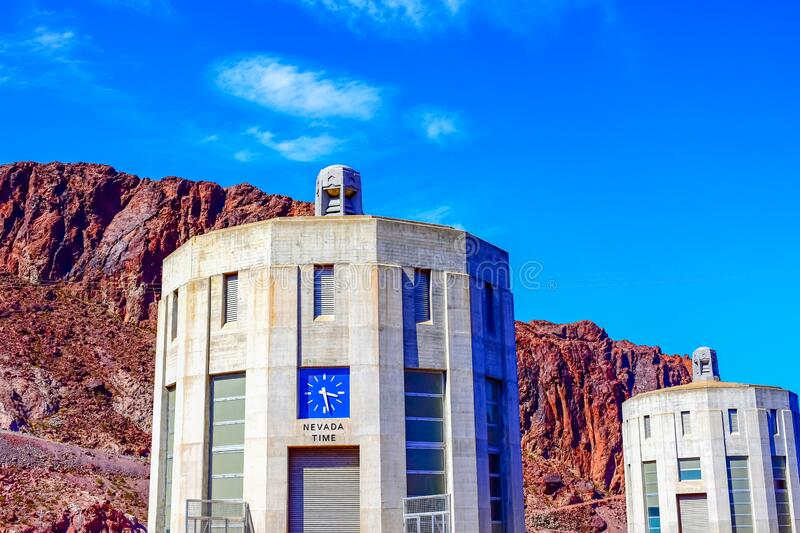 Hoover Dam Clock in Nevada / Arizona. DescriptionHoover Dam is a concrete arch-gravity dam in the Black Canyon of the Colorado River, on the border between the U stock image