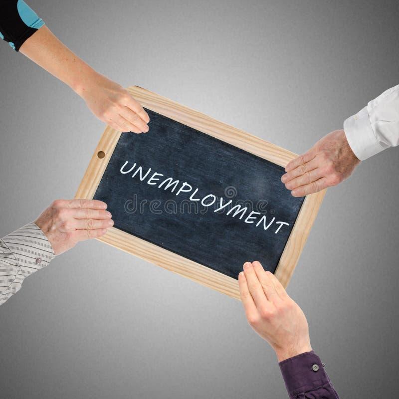 Desempleo de la palabra escrito en la pizarra fotos de archivo