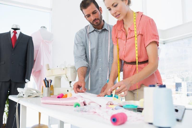 Desenhadores de moda no trabalho no estúdio brilhante fotografia de stock royalty free