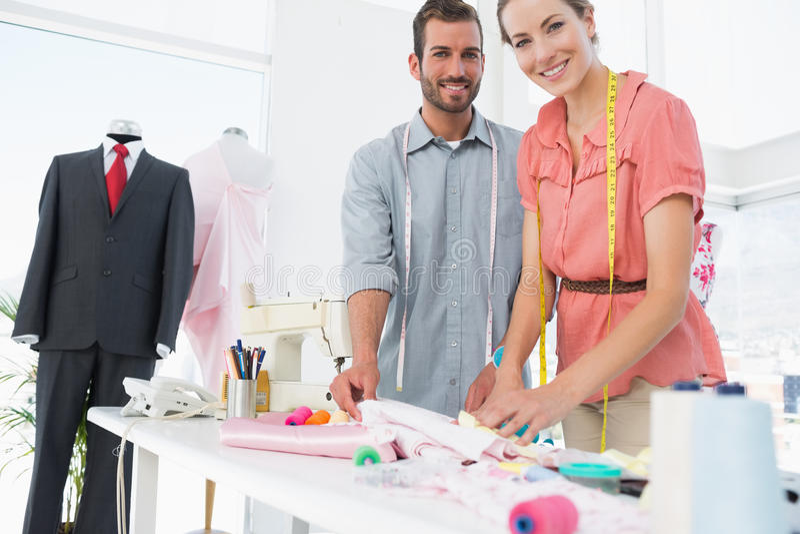 Desenhadores de moda no trabalho no estúdio brilhante foto de stock royalty free