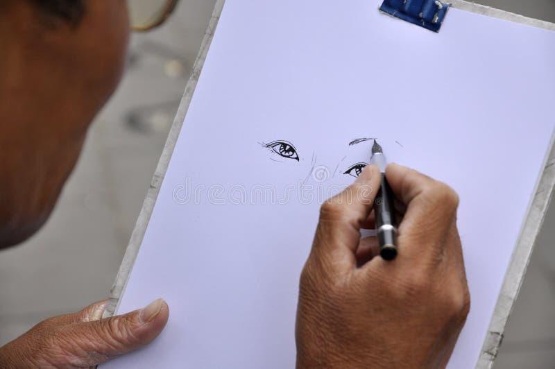 Desenhando um retrato imagens de stock royalty free