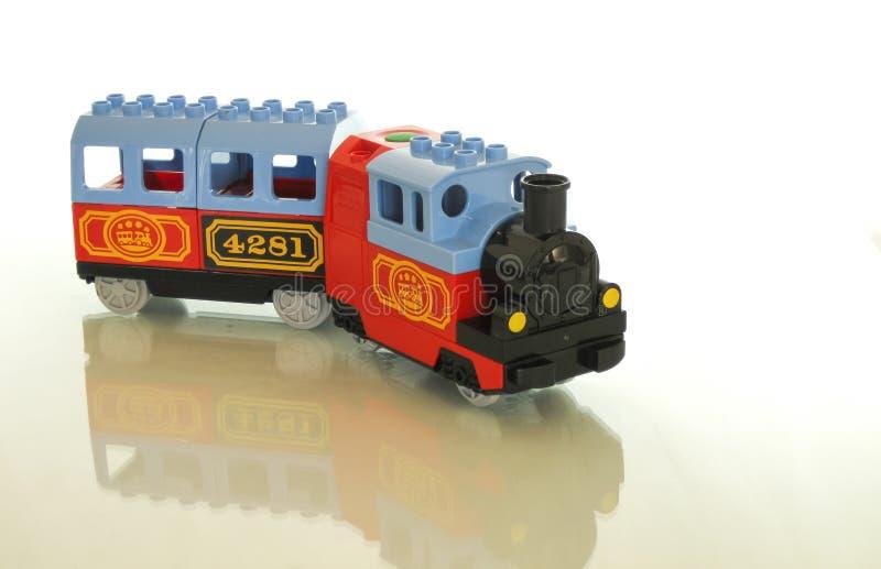 Desenhista e trem - uma grande combinação para um brinquedo fotos de stock
