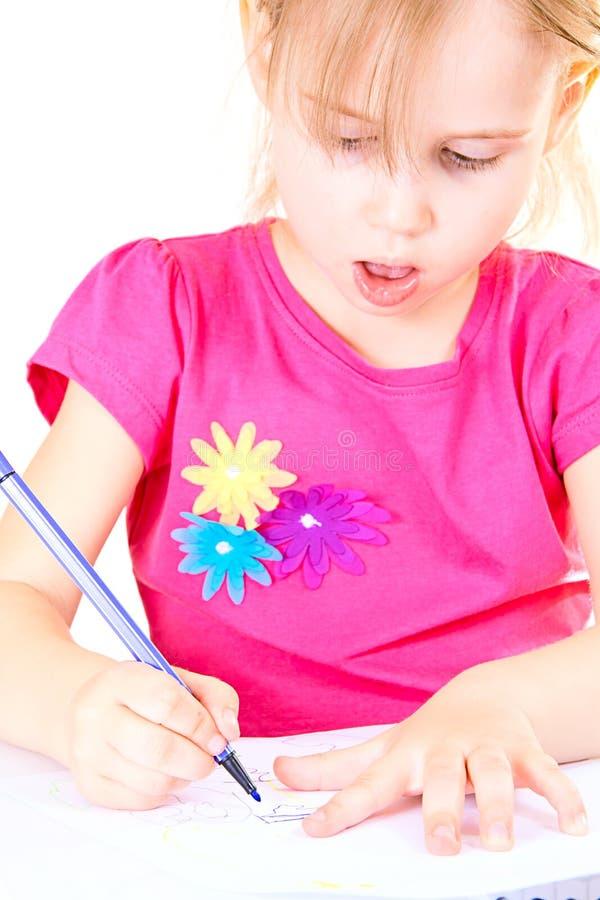 Desenho da menina em uma tabela branca foto de stock