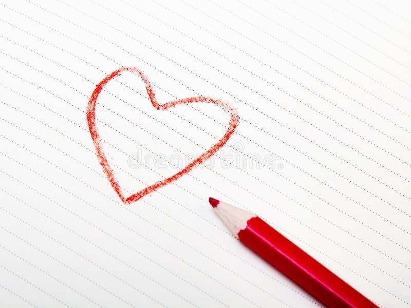 Desenho do coração no Livro Branco foto de stock