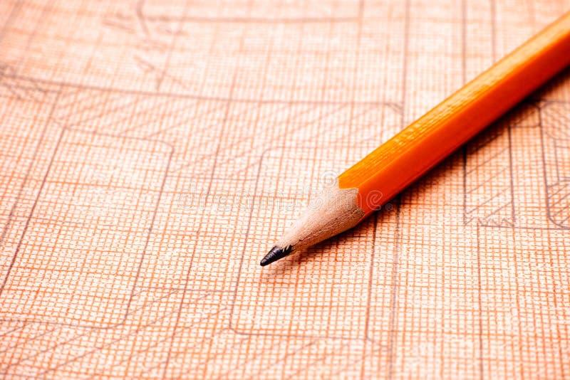 Desenho técnico velho no papel de gráfico com lápis alaranjado fotografia de stock