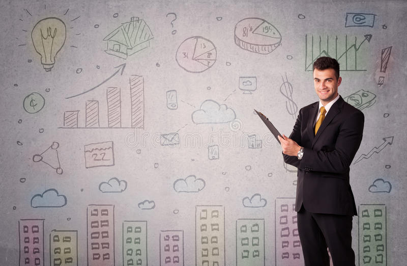 Desenhos coloridos na parede com homem de negócios fotografia de stock royalty free