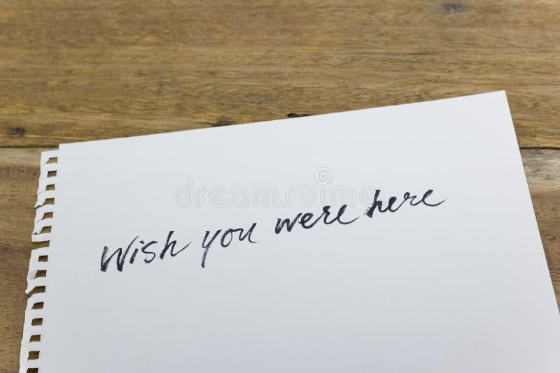 deseo usted estaba aquí mano escrita en el Libro Blanco foto de archivo libre de regalías