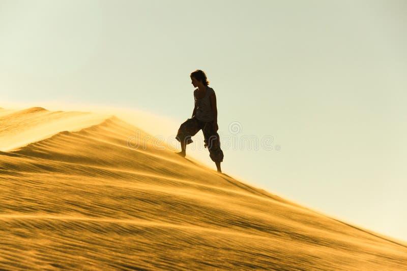 Desert. Woman on the sand in desert. Egypt stock photo