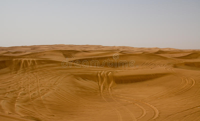 Desert area in Dubai, UAE. Tourists are often taken to this location for desert safaris and dune bashing. Desert area in Dubai, UAE. Tourists are taken to this royalty free stock photo