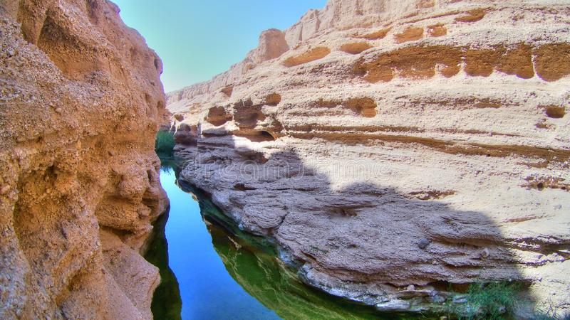 Desert canyon in Iran and its river. Jinni Canyon, or as local people say Kal-e Jenni, is one of the most mysterious and stunning valleys in Iran, situated in stock photography