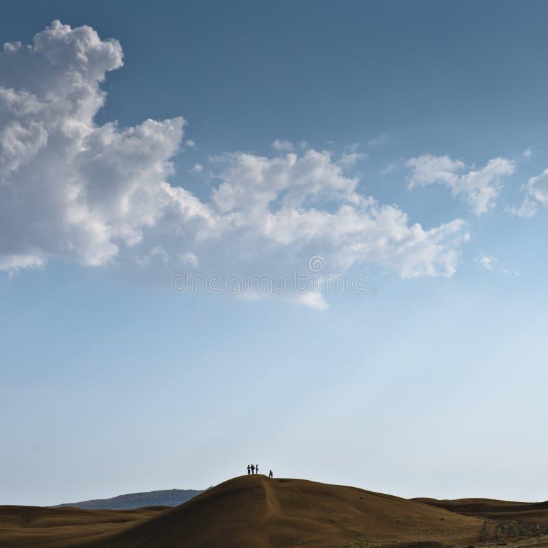 Desert and cloudy sky stock photos