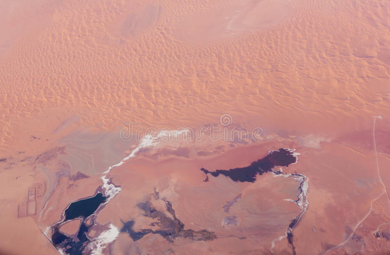 Desert coming. Expanding Desert Landscape. View from above royalty free stock photo
