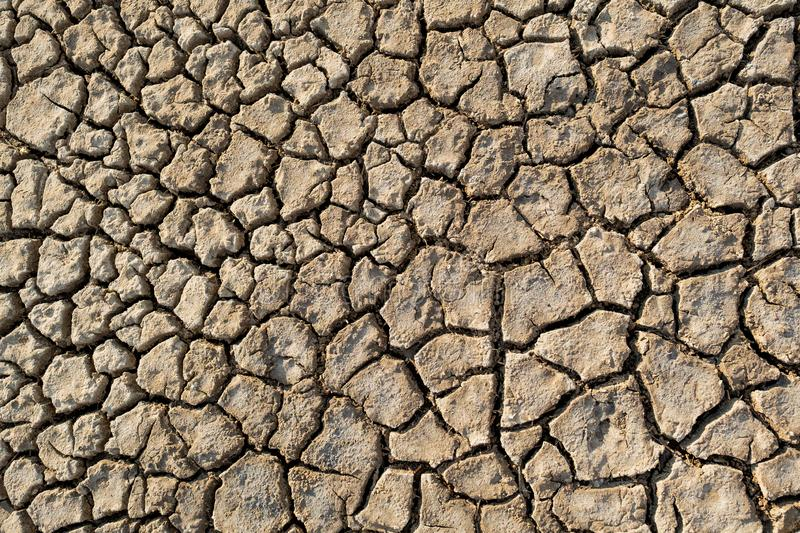 Desert heat dirt clay global warming texture pattern top view royalty free stock photo