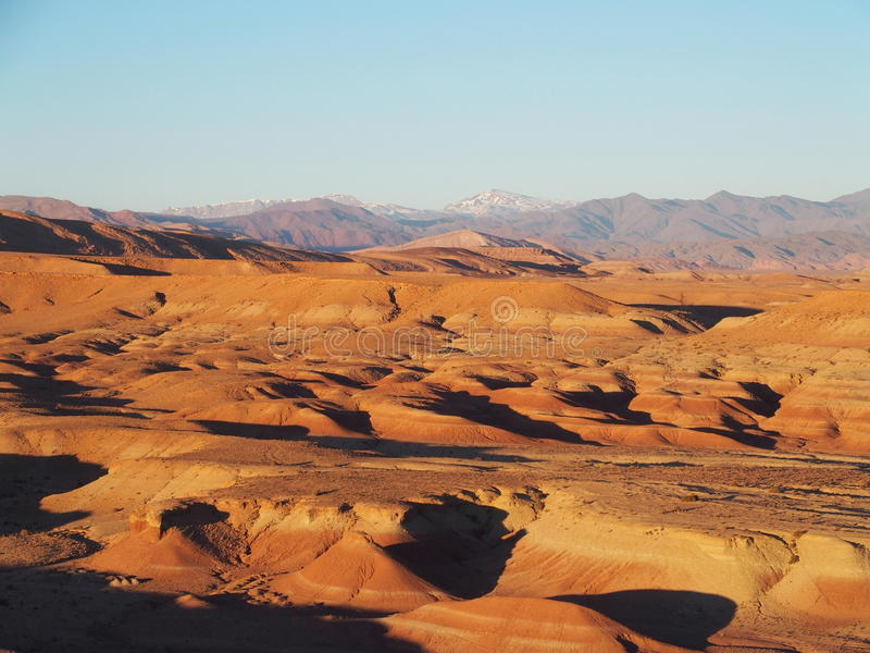 Desert and high ATLAS MOUNTAINS range landscape in central Morocco royalty free stock image