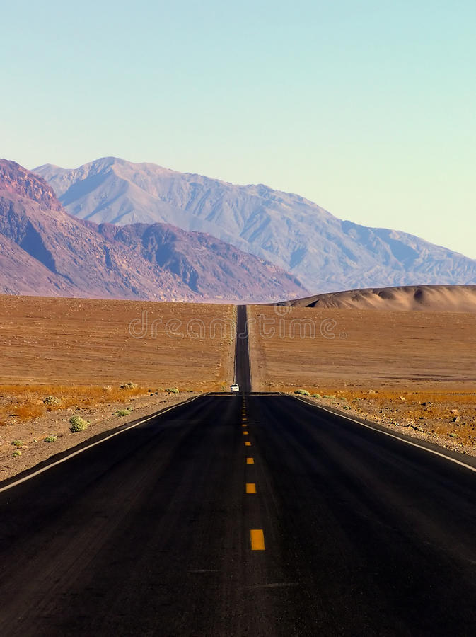 Desert highway and mountains, Death Valley NP royalty free stock images