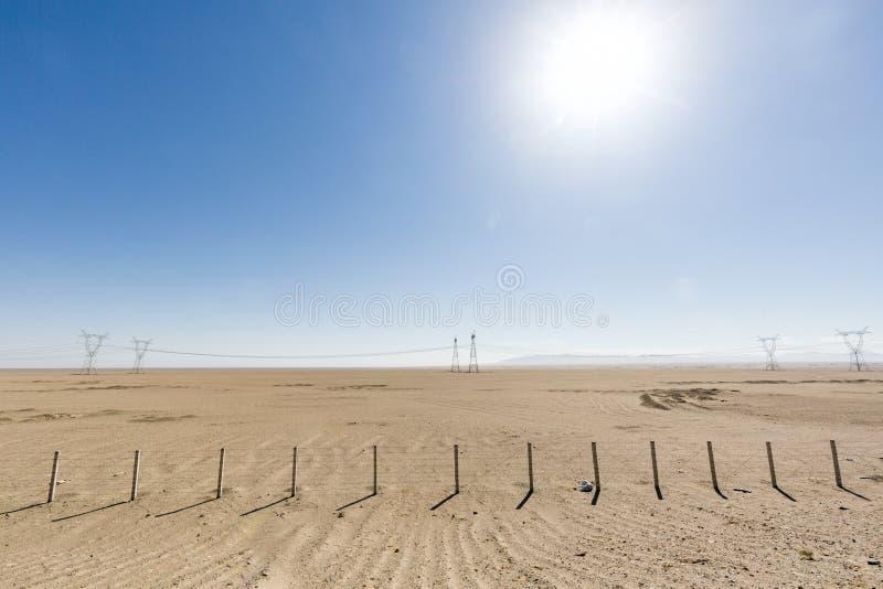 Desert highway in the no-man`s land stock image