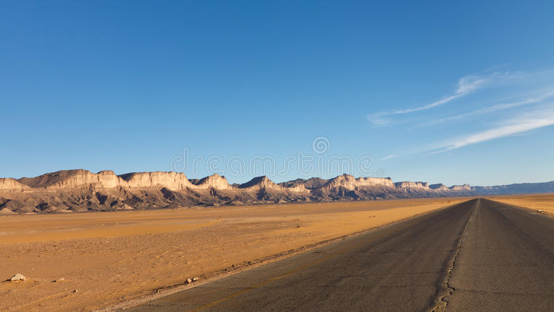 Desert Higway, Akakus (Acacus) Mountains, Sahara. Road to Infinity - Desert higway, Akakus (Acacus) Mountains, Sahara, Libya royalty free stock photography