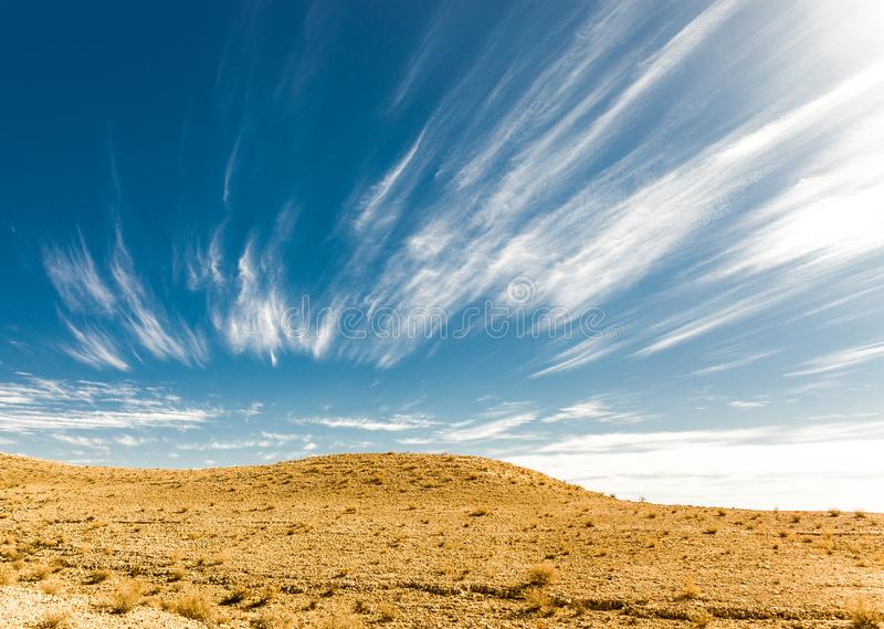 Desert hill clouds shapes, south Israel landscape. Desert sky clouds shapes scenic hills landscape view, Arif crater Negev desert, travel Israel nature stock photo