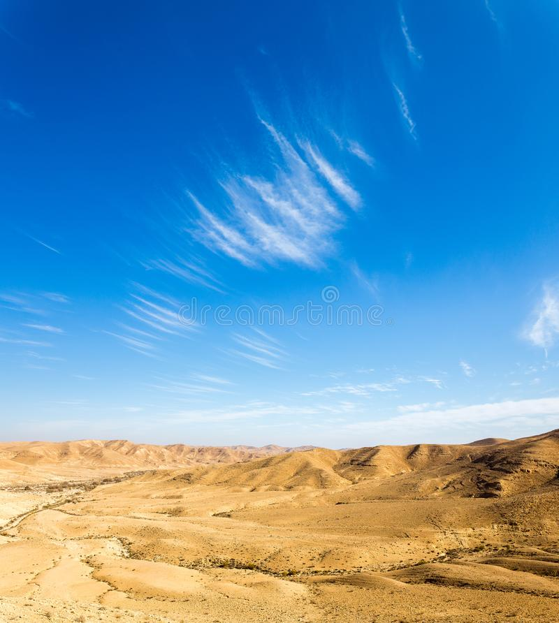 Desert hill clouds shapes, south Israel landscape. Desert sky clouds shapes scenic hills landscape view, Arif crater Negev desert, travel Israel nature royalty free stock photos