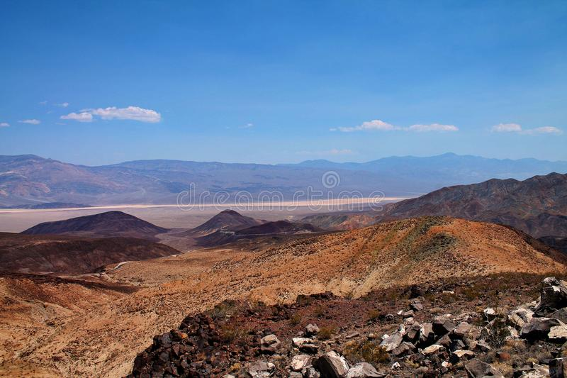 Desert hills with distant mountains and sandy lowland near Death Valley, USA royalty free stock photos